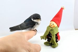 figurine pet perched hand small animal finger cute
