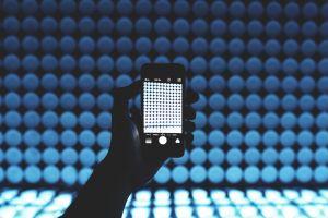 futuristic design electronics person dark close-up technology blur mobile pattern