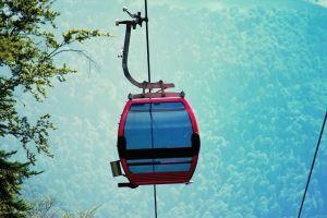 gondola tele gondola trees mountain blurred background green summer
