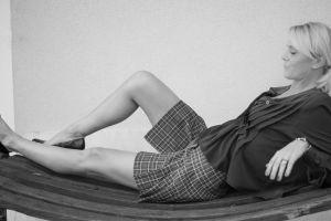 grape sensual black and white seduction fashion model eating female model blonde relaxed enjoying