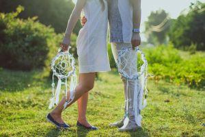 green dream catcher sun sunlight couple hands man love woman legs