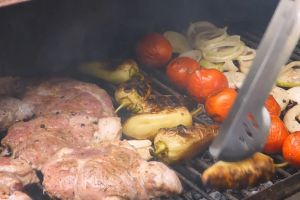 grill hot flame meat close-up grilling vegetables tong food delicious