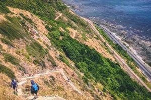 hike cliff high mountain greenery hikers sea highway escarpment grass