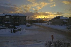 houses cars roads sunset vehicles snow cold buildings