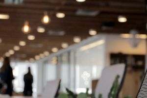 indoors people. office lights blurred corporate blurry