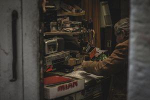 indoors person tools portrait wear workshop man electronics