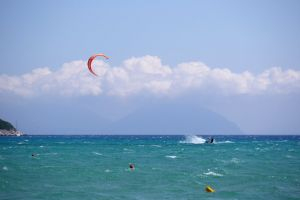 kitesurfing clouds sky spray high speed