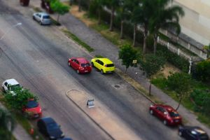 lamppost road cars high angle shot building trees street people highway