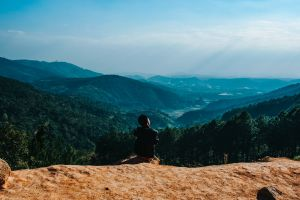 landscape cliff person climb scenic hike mountain