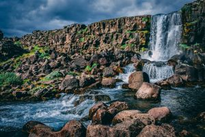 landscape scenic mountain flowing sky water boulders daylight nature mossy rocks