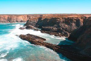 landscape sea waves teal and orange ocean water cliff