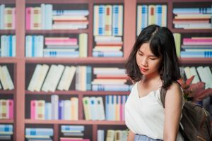 library woman blur bookshelves indoors red lips bookcase wear looking books