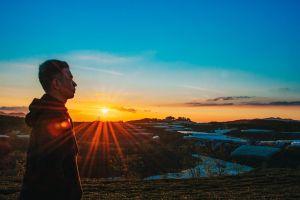 light man scenic side view environment sunrise tranquil sky sun backlit