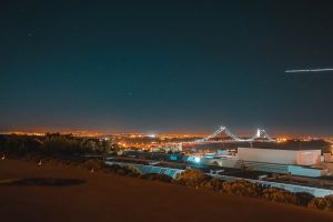 long exposure night sky 25 de abril bridge light plane