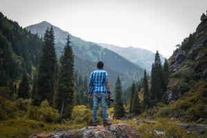 majestic scenic photography mountains mountain peak daylight trees hike rocks woods