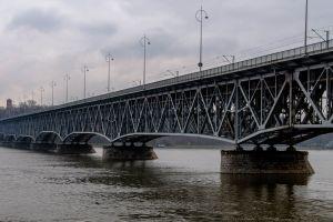 modern bridge landmark daylight water long sky clouds road steel