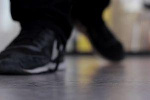 nike rubber shoes shoelace tying footwear hands blur person man