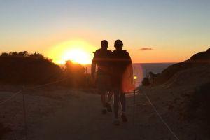 ocean sea walking sunset people