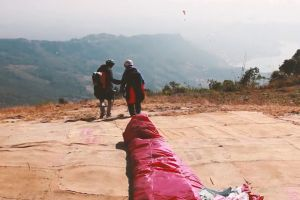 people paragliding nature mountain adventure clouds sky