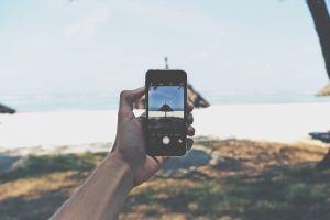 person screen daylight iphone 6 seashore landscape cellphone beach hand technology