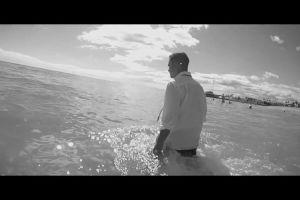person shore swimming beach black-and-white sand man