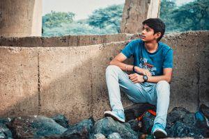 photoshoot sitting stones wear boy model fashion man pose landscape