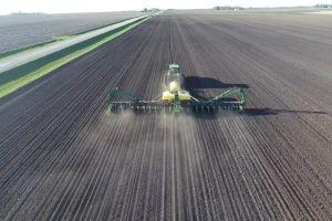 planting farm field modern tractor