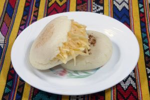 plate fast food food arepa corn cheese