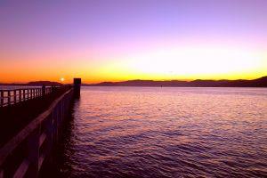 purple sky sea evening sky moon pier boardwalk evening sun dramatic sky promenade ocean