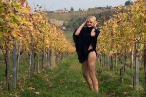 relaxed sexy blonde woman fashion model napa vineyard vine sensual grapes female model