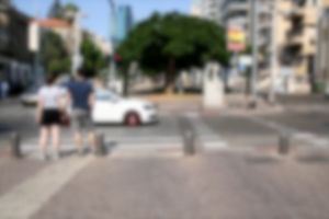road people vehicles blur cars street couple crossing