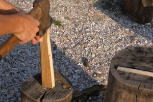 rocks stump person work working woods daylight axe hands