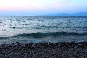 rocks waves seashore sea beach water daytime