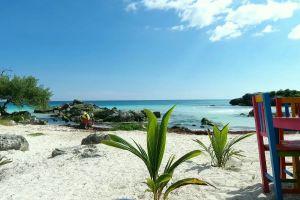 sand chairs water ocean beach waves sky shore coast person