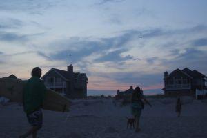 sand people houses sky shore
