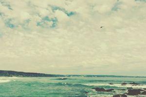 sand seashore sea beach rocks coast splash ocean waves