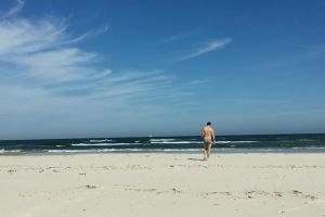 sand summer person seashore waves sky man beach walking sea