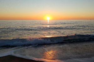 sea beach horizon waves reflection sand seashore water sunset seascape