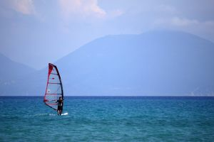 sea solitary sail sky windsurfer haze
