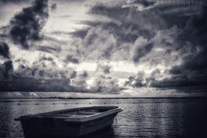 seashore clouds boat ocean