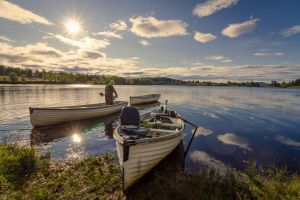 shore landscape canoe grass daylight vehicle rowboat reflection sun watercraft