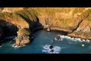 shore rocks water ocean waves sea coast lighthouse
