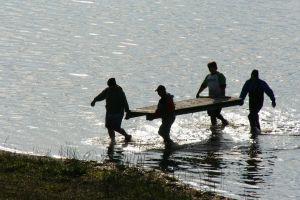 shore teamwork splashing lakeside work wetland team work crew work crew lakeshore
