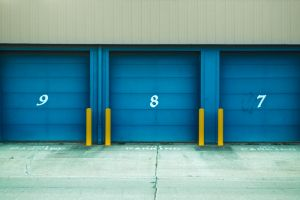 shutter doors numbers street wall parking blue asphalt urban pavement building