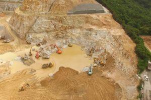 site brown water sand trucks aerial shot construction mud working