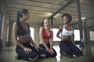 sitting locomotive yoga fit fitness women friends girls smiling leisure