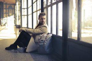 sitting man glass pose coat fashion windows person handsome wear