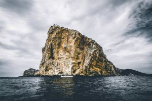 sky seashore water landscape cliff rock summer ocean lighthouse beach