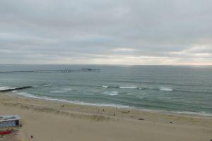 sky shore pier waves coast aerial shot ocean water sea