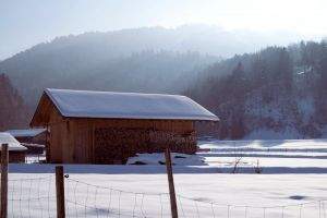 snowy trees wooden cabin snow sunbeams wire fence alps fence mountains hut